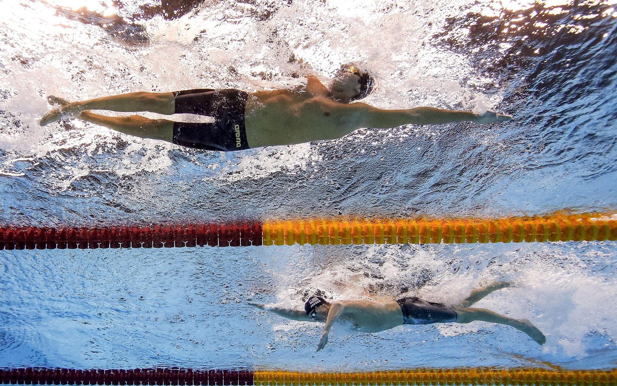 epa05482884 Gregorio Patrinieri of Italy (top) and Connor Jaeger of USA compete in the men's 1500m Freestyle Final race of the Rio 2016 Olympic Games Swimming events at Olympic Aquatics Stadium at the Olympic Park in Rio de Janeiro, Brazil, 14 August 2016.  EPA/PATRICK B. KRAEMER