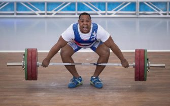 epa09155811 Cuban Jesus Quesada competes in the 102kg category during the competition of the Pan American Senior Weightlifting Championship, in Santo Domingo, Dominican Republic, 23 April 2021. This is the last continental weightlifting qualifying tournament for the Tokyo 2020 Olympics.  EPA/Orlando Barria