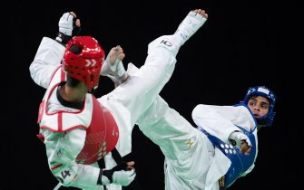 epa07087095 Nisar Ahmad Abdul Rahimzai of Afghanistan (R) and Mohammadali Khosravi of Iran (L) compete in the Taekwondo Mens 73kg Semi-final in the Oceania Pavilion, Youth Olympic Parkduring the Youth Olympic Games, Buenos Aires, Argentina, 11 October 2018.  EPA/Lukas Schulze  for OIS/IOC HANDOUT  HANDOUT EDITORIAL USE ONLY/NO SALES