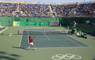 epa05484569 A general view for the game between Kei Nishikori of Japan and Rafael Nadal of Spain for the Bronze medal at Rio 2016 Olympic Games at the Olympic Tennis Center in Rio de Janeiro, Brazil, 14 August 2016.  EPA/MICHAEL REYNOLDS