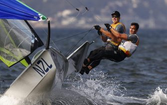 epaselect epa05497563 Peter Burling and Blair Tuke of New Zealand react after winning the gold medal in the men's 49er class medal race of the Rio 2016 Olympic Games Sailing events in Rio de Janeiro, Brazil, 18 August 2016.  EPA/NIC BOTHMA
