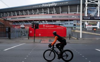 CARDIFF, UNITED KINGDOM - MARCH 14: A cyclist cycles past the Principality Stadium on March 14, 2020 in Cardiff, Wales. The Six Nations fixture in Cardiff between Wales and Scotland at the Principality Stadium was postponed 24 hours before kick-off due to concerns about the spread of the coronavirus. (Photo by Matthew Horwood/Getty Images)