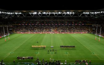 BRISBANE, AUSTRALIA - NOVEMBER 07: Wallabies and All Blacks players stand during the national anthems prior to the 2020 Tri-Nations match between the Australian Wallabies and the New Zealand All Blacks at Suncorp Stadium on November 07, 2020 in Brisbane, Australia. (Photo by Matt Roberts/Getty Images)