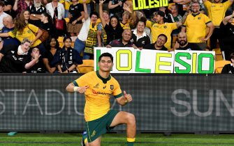 BRISBANE, AUSTRALIA - NOVEMBER 07: Noah Lolesio of the Wallabies celebrates victory with the fans after the 2020 Tri-Nations match between the Australian Wallabies and the New Zealand All Blacks at Suncorp Stadium on November 07, 2020 in Brisbane, Australia. (Photo by Bradley Kanaris/Getty Images)