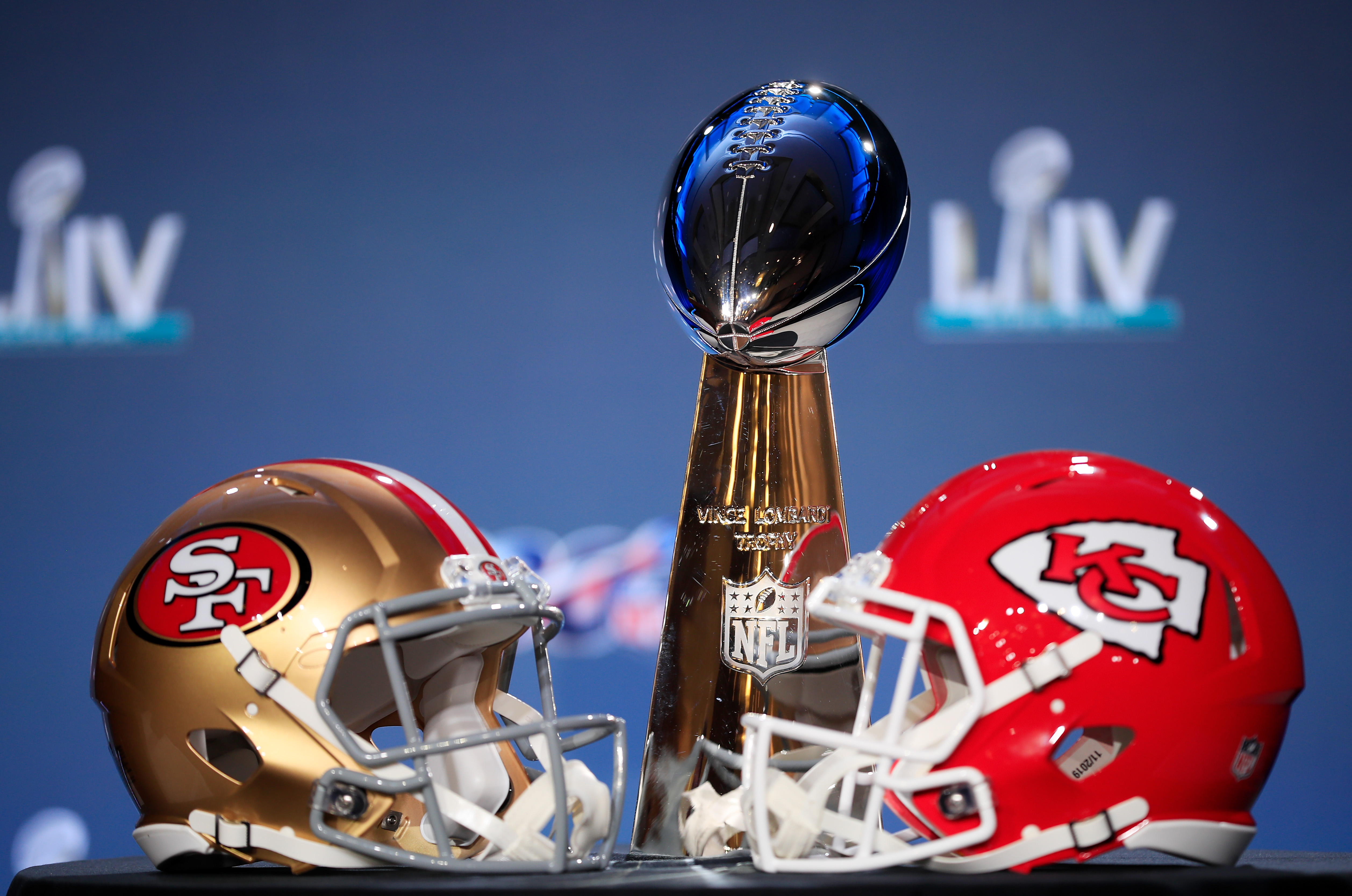 MIAMI, FLORIDA - JANUARY 29: The Vince Lombardi Trophy is displayed with helmets of the San Francisco 49ers and Kansas City Chiefs prior to a press conference with NFL Commissioner Roger Goodell for Super Bowl LIV at the Hilton Miami Downtown on January 29, 2020 in Miami, Florida. The 49ers will face the Chiefs in the 54th playing of the Super Bowl, Sunday February 2nd. (Photo by Cliff Hawkins/Getty Images)