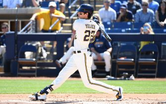 MARYVALE, ARIZONA - MARCH 06: Christian Yelich #22 of the Milwaukee Brewers follows through on a swing during the first inning of a spring training game against the San Francisco Giants at American Family Fields of Phoenix on March 06, 2020 in Maryvale, Arizona. (Photo by Norm Hall/Getty Images)
