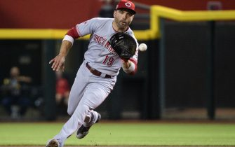 PHOENIX, ARIZONA - SEPTEMBER 14: Joey Votto #19 of the Cincinnati Reds fields a ground ball in the first inning of the MLB game against the Arizona Diamondbacks at Chase Field on September 14, 2019 in Phoenix, Arizona. (Photo by Jennifer Stewart/Getty Images)