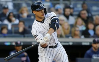 NEW YORK, NEW YORK - OCTOBER 05:  (NEW YORK DAILIES OUT)   Giancarlo Stanton #27 of the New York Yankees in action against the Minnesota Twins in game two of the American League Division Series at Yankee Stadium on October 05, 2019 in New York City. The Yankees defeated the Twins 8-2.  (Photo by Jim McIsaac/Getty Images)