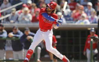 CLEARWATER, FLORIDA - MARCH 07:  Bryce Harper #3 of the Philadelphia Phillies hits a double against the Boston Red Sox in the first inning of a Grapefruit League spring training game on March 07, 2020 in Clearwater, Florida. (Photo by Michael Reaves/Getty Images)