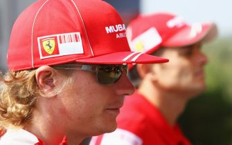 MONZA, ITALY - SEPTEMBER 10:  Kimi Raikkonen (L) of Finland and Ferrari and Giancarlo Fisichella (R) of Italy and Ferrari are seen during previews to the Italian Formula One Grand Prix on September 10, 2008 in Monza, Italy.  (Photo by Clive Rose/Getty Images)