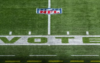 """FOXBOROUGH, MASSACHUSETTS - OCTOBER 25: The word """"vote"""" is seen on the field before a game between the New England Patriots and the San Francisco 49ers on October 25, 2020 in Foxborough, Massachusetts. (Photo by Adam Glanzman/Getty Images)"""