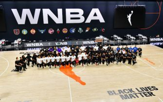 PALMETTO, FLORIDA - AUGUST 26:  The Atlanta Dream, Washington Mystics, Minnesota Lynx, and the Los Angeles Sparks kneel on the court after the teams collectively decided to postpone games at Feld Entertainment Center on August 26, 2020 in Palmetto, Florida. Several sporting leagues across the nation today are postponing their schedules as players protest the shooting of Jacob Blake by Kenosha, Wisconsin police. NOTE TO USER: User expressly acknowledges and agrees that, by downloading and or using this photograph, User is consenting to the terms and conditions of the Getty Images License Agreement. (Photo by Julio Aguilar/Getty Images)