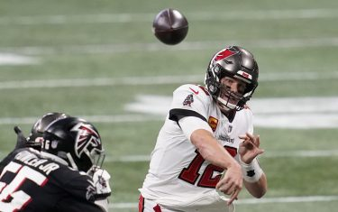 Dec 20, 2020; Atlanta, Georgia, USA; Tampa Bay Buccaneers quarterback Tom Brady (12) throws a pass against the Atlanta Falcons in the second half of a NFL game at Mercedes-Benz Stadium. Mandatory Credit: Dale Zanine-USA TODAY Sports/Sipa USA