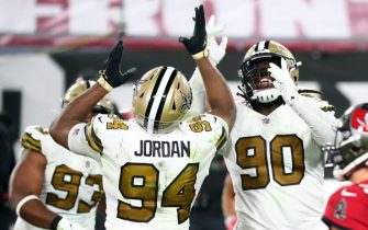 Nov 8, 2020; Tampa, Florida, USA; New Orleans Saints defensive tackle Malcom Brown (90) celebrates with  defensive end Cameron Jordan (94) as he sacks Tampa Bay Buccaneers quarterback Tom Brady (12) (not pictured) during the second half at Raymond James Stadium. Mandatory Credit: Kim Klement-USA TODAY Sports/Sipa USA