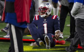 epa08908663  New England Patriots quarterback Cam Newton reacts after being pushed out of bounds by the Buffalo Bills in the first half of their NFL game at Gillette Stadium in Foxborough, Massachusetts, USA, 28 December 2020.  EPA/CJ GUNTHER