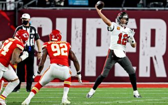 Feb 4, 2020; Tampa, FL, USA;  Tampa Bay Buccaneers quarterback Tom Brady (12) throws a pass during the first quarter against the Kansas City Chiefs in Super Bowl LV at Raymond James Stadium.  Mandatory Credit: Matthew Emmons-USA TODAY Sports/Sipa USA