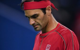 Roger Federer of Switzerland looks down while playing against Alexander Zverev of Germany during their men's singles quarter-final match at the Shanghai Masters tennis tournament in Shanghai on October 11, 2019. (Photo by HECTOR RETAMAL / AFP) (Photo by HECTOR RETAMAL/AFP via Getty Images)