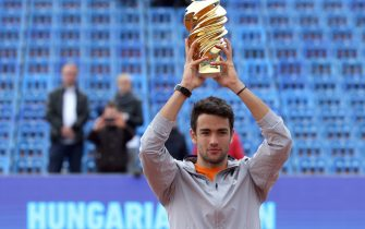 Italy's Matteo Berrettini poses with the trophy after his victory over Serbia's Filip Krajinovic during the ATP final tennis match at the Hungarian Open in Budapest, on April 28, 2019. (Photo by Peter Kohalmi / AFP)        (Photo credit should read PETER KOHALMI/AFP via Getty Images)