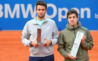 MUNICH, GERMANY - MAY 05: Cristian Garin (L) of Chile poses his winners trophy for the BMW Open 2019 after winning his final match against Matteo Berrettini of Italy on day 9 of the BMW Open at MTTC IPHITOS on May 05, 2019 in Munich, Germany. (Photo by Alexander Hassenstein/Getty Images for BMW)