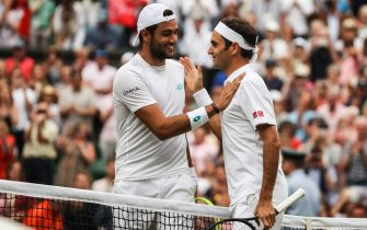 LONDON, ENGLAND - JULY 08: Roger Federer (R) of Switzerland greets Matteo Berrettini of Italy after their Men's Singles fourth round match against during Day Seven of The Championships - Wimbledon 2019 at All England Lawn Tennis and Croquet Club on July 08, 2019 in London, England. (Photo by Shi Tang/Getty Images)