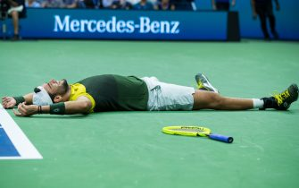 NEW YORK, NEW YORK - SEPTEMBER 04: Matteo Berrettini of Italy falls to the court in celebration of his Men's Singles quarterfinals victory against Gael Monfils of France on day ten of the 2019 US Open at the USTA Billie Jean King National Tennis Center on September 04, 2019 in Queens borough of New York City. (Photo by Chaz Niell/Getty Images)