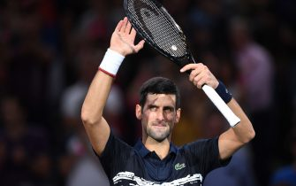 Serbia's Novak Djokovic celebrates after winning against Britain's Kyle Edmund during their men's singles tennis match on day four of the ATP World Tour Masters 1000 - Rolex Paris Masters - indoor tennis tournament at The AccorHotels Arena in Paris on October 31, 2019. (Photo by Christophe ARCHAMBAULT / AFP) (Photo by CHRISTOPHE ARCHAMBAULT/AFP via Getty Images)