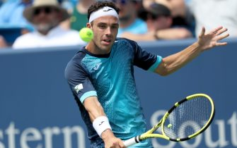 MASON, OHIO - AUGUST 11: Marco Cecchinato of Italy returns a shot to Alex de Minaur of Australia during Day 2 of the Western and Southern Open at Lindner Family Tennis Center on August 11, 2019 in Mason, Ohio. (Photo by Rob Carr/Getty Images)