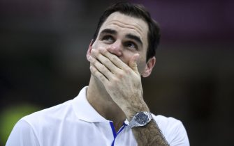 BUENOS AIRES, ARGENTINA - NOVEMBER 20:  Roger Federer of Switzerland reacts with tears as he watches a surprise video from former Argentine football player and coach Diego Maradona talking about him after an exhibition game between Alexander Zverev and Roger Federer at Arena Parque Roca on November 20, 2019 in Buenos Aires, Argentina. (Photo by Marcelo Endelli/Getty Images)