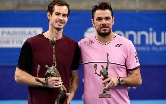 Winner Britain's Andy Murray (L) and second-placed Switzerland's Stanislas Wawrinka (R) celebrate with their trophies after competing in their men's single tennis final match of the European Open ATP Antwerp, on October 20, 2019 in Antwerp. (Photo by JOHN THYS / BELGA / AFP) / Belgium OUT (Photo by JOHN THYS/BELGA/AFP via Getty Images)