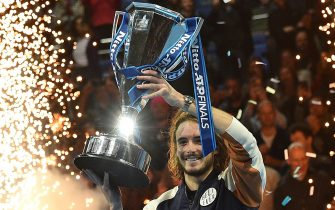 Greece's Stefanos Tsitsipas poses with the winner's trophy after winning the men's singles final match on day eight of the ATP World Tour Finals tennis tournament at the O2 Arena in London on November 17, 2019. - Tsitsipas beat Austria's Dominic Thiem to win the match 6-7, 6-2, 7-6. (Photo by Glyn KIRK / AFP) (Photo by GLYN KIRK/AFP via Getty Images)