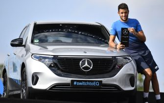 Italy's Matteo Berrettini poses with his trophy next to the full electric Mercedes-Benz EQC Edition 1886 that he won after defeating Canada's Felix Auger-Aliassime in their final at the ATP Mercedes Cup tennis tournament in Stuttgart, southwestern Germany, on June 16, 2019. (Photo by THOMAS KIENZLE / AFP)        (Photo credit should read THOMAS KIENZLE/AFP via Getty Images)