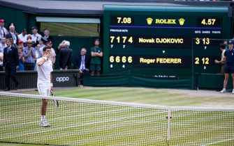 LONDON, ENGLAND - JULY 14: Novak Djokovic of Serbia in front of the scoreboard after defeating Roger Federer of Switzerland (not pictured) during the Men's Singles Final at The Wimbledon Lawn Tennis Championship at the All England Lawn and Tennis Club at Wimbledon on July 14, 2019 in London, England. (Photo by Simon Bruty/Anychance/Getty Images)