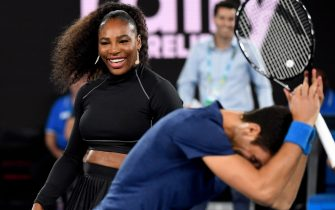 Serena Williams of the US and Novak Djokovic of Serbia share a lighter moment as they and other top players play in the Rally for Relief charity tennis match in support of the victims of the Australian bushfires, in Melbourne of January 15, 2020, ahead of the Australian Open tennis tournament. (Photo by WILLIAM WEST / AFP) / -- IMAGE RESTRICTED TO EDITORIAL USE - STRICTLY NO COMMERCIAL USE -- (Photo by WILLIAM WEST/AFP via Getty Images)