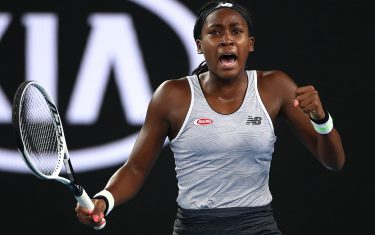 MELBOURNE, AUSTRALIA - JANUARY 20: Coco Gauff of the United States of America celebrates winning the first set during her Women's Singles first round match against Venus Williams of the United States of America on day one of the 2020 Australian Open at Melbourne Park on January 20, 2020 in Melbourne, Australia. (Photo by Cameron Spencer/Getty Images)
