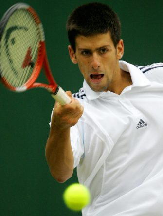 LONDON, United Kingdom:  Novak Djokovic of Serbia and Montenegro hits a forehand to Sebastien Grosjean of France during their match at the 119th Wimbledon Tennis Championships in London, 25 June, 2005.  AFP PHOTO/ODD ANDERSEN  (Photo credit should read ODD ANDERSEN/AFP via Getty Images)