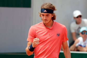 Greece's Stefanos Tsitsipas reacts after a point during his men's singles second round match against Austria's Dominic Thiem on day five of The Roland Garros 2018 French Open tennis tournament in Paris on May 31, 2018. (Photo by Thomas SAMSON / AFP)        (Photo credit should read THOMAS SAMSON/AFP via Getty Images)