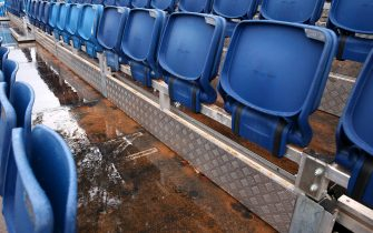 MELBOURNE, AUSTRALIA - JANUARY 23: Dirt is seen in the spectator stands after is was caused by rainfall on day four of the 2020 Australian Open at Melbourne Park on January 23, 2020 in Melbourne, Australia. (Photo by Mike Owen/Getty Images)