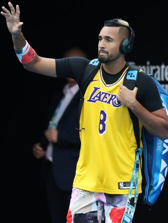 MELBOURNE, AUSTRALIA - JANUARY 27: Nick Kyrgios of Australia walks onto Rod Laver Arena wearing a number 8 Kobe Bryant Jersey ahead of his Men's Singles fourth round match against Rafael Nadal of Spain on day eight of the 2020 Australian Open at Melbourne Park on January 27, 2020 in Melbourne, Australia. (Photo by Mark Kolbe/Getty Images)