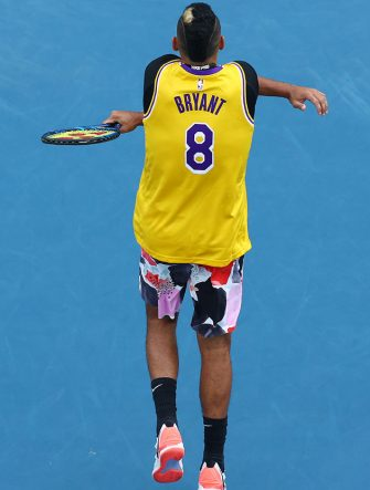 MELBOURNE, AUSTRALIA - JANUARY 27: Nick Kyrgios of Australia warms up wearing a number 8 Kobe Bryant Jersey ahead of his Men's Singles fourth round match against Rafael Nadal of Spain on day eight of the 2020 Australian Open at Melbourne Park on January 27, 2020 in Melbourne, Australia. (Photo by Cameron Spencer/Getty Images)