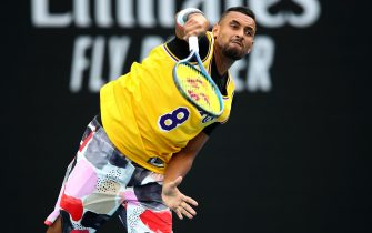 MELBOURNE, AUSTRALIA - JANUARY 27: Nick Kyrgios of Australia serves as he warms up wearing a number 8 Kobe Bryant Jersey ahead of his Men's Singles fourth round match against Rafael Nadal of Spain on day eight of the 2020 Australian Open at Melbourne Park on January 27, 2020 in Melbourne, Australia. (Photo by Clive Brunskill/Getty Images)