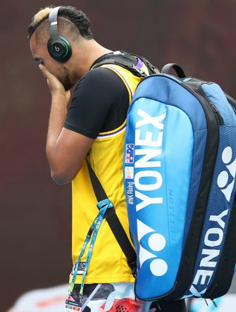 MELBOURNE, AUSTRALIA - JANUARY 27: Nick Kyrgios of Australia tears up as he walks onto Rod Laver Arena wearing a number 8 Kobe Bryant Jersey ahead of his Men's Singles fourth round match against Rafael Nadal of Spain on day eight of the 2020 Australian Open at Melbourne Park on January 27, 2020 in Melbourne, Australia. (Photo by Clive Brunskill/Getty Images)