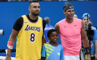 Australia's Nick Kyrgios (L) wears a Los Angeles Lakers jersey with former basketball player Kobe Bryant's number as he poses with Spain's Rafael Nadal before the start of their men's singles match on day eight of the Australian Open tennis tournament in Melbourne on January 27, 2020. (Photo by Saeed KHAN / AFP) / IMAGE RESTRICTED TO EDITORIAL USE - STRICTLY NO COMMERCIAL USE (Photo by SAEED KHAN/AFP via Getty Images)