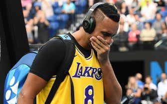 MELBOURNE, AUSTRALIA - JANUARY 27: Nick Kyrgios of Australia tears up as he walks onto Rod Laver Arena wearing a number 8 Kobe Bryant Jersey ahead of his Men's Singles fourth round match against Rafael Nadal of Spain on day eight of the 2020 Australian Open at Melbourne Park on January 27, 2020 in Melbourne, Australia. (Photo by Quinn Rooney/Getty Images)