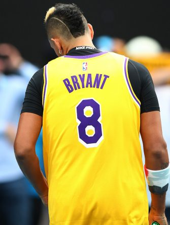 MELBOURNE, AUSTRALIA - JANUARY 27: Nick Kyrgios of Australia warms up wearing a number 8 Kobe Bryant Jersey ahead of his Men's Singles fourth round match against Rafael Nadal of Spain on day eight of the 2020 Australian Open at Melbourne Park on January 27, 2020 in Melbourne, Australia. (Photo by Clive Brunskill/Getty Images)