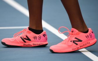 Coco Gauff of the US wearing a hand-written number on her shoe of NBA star Kobe Bryant's Los Angeles Lakers jersey play along with her teammate Catherine McNally of the US against Japan's Shuko Aoyama and Ena Shibahara during their women's doubles match on day eight of the Australian Open tennis tournament in Melbourne on January 27, 2020. (Photo by Manan VATSYAYANA / AFP) / IMAGE RESTRICTED TO EDITORIAL USE - STRICTLY NO COMMERCIAL USE (Photo by MANAN VATSYAYANA/AFP via Getty Images)