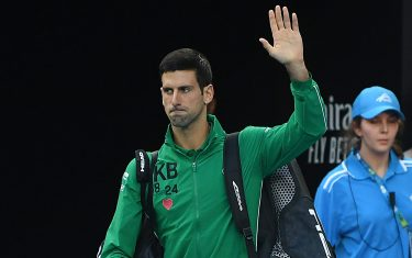 MELBOURNE, AUSTRALIA - JANUARY 28: Novak Djokovic of Serbia waves to the crowd before his Men s Singles Quarterfinal match against Milos Raonic of Canada on day nine of the 2020 Australian Open at Melbourne Park on January 28, 2020 in Melbourne, Australia. (Photo by Morgan Hancock/Getty Images)
