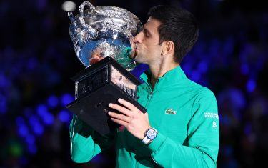 MELBOURNE, AUSTRALIA - FEBRUARY 02: Novak Djokovic of Serbia kisses the Norman Brookes Challenge Cup after winning the Men's Singles Final against Dominic Thiem of Austria on day fourteen of the 2020 Australian Open at Melbourne Park on February 02, 2020 in Melbourne, Australia. (Photo by Cameron Spencer/Getty Images)