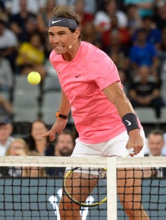 Spain's Rafael Nadal plays a return to Switzerland's Roger Federer and American philanthropist Bill Gates during their double's tennis match at The Match in Africa at the Cape Town Stadium, in Cape Town on February 7, 2020. (Photo by RODGER BOSCH / AFP) (Photo by RODGER BOSCH/AFP via Getty Images)