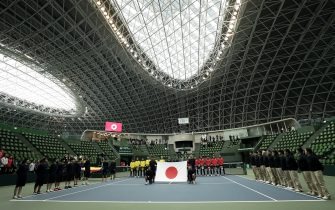 MIKI, JAPAN - MARCH 06: Members of the Japan Davis Cup team (2nd R) line up for the national anthem at the opening ceremony on day one of the Davis Cup qualifier between Japan and Ecuador at the Bourbon Beans Dome on March 06, 2020 in Miki, Hyogo, Japan. The 2-day qualifier is held behind closed doors due to novel coronavirus outbreak. (Photo by Kiyoshi Ota/Getty Images)