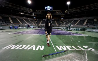 INDIAN WELLS, CALIFORNIA - MARCH 08:  Courtmaster Jeffrey Brooker cleans the center court at the Indian Wells Tennis Garden on March 08, 2020 in Indian Wells, California. The BNP Paribas Open was cancelled by the Riverside County Public Health Department, as county officials declared a public health emergency when a case of coronavirus (COVID-19) was confirmed in the area. (Photo by Al Bello/Getty Images)